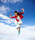 Beautiful dancing girl jumping sport and urban culture concept Stock Photo
