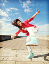 Beautiful dancing girl in movement sport and urban culture concept Royalty Free Stock Image