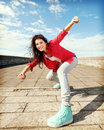 Beautiful dancing girl in movement sport and urban culture concept Stock Images