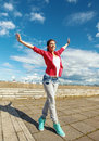 Beautiful dancing girl in movement sport and urban culture concept with raised hands Stock Photography