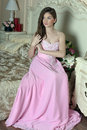 Beautiful dark-haired girl in the pink evening dress Royalty Free Stock Photo