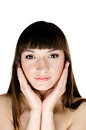 Beautiful dark-haired woman touching her face Royalty Free Stock Photography