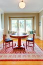 Beautiful decor of dining room with beige, blue and red. Royalty Free Stock Photo