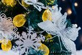 Beautiful decorated christmas tree with snow on the blurred bokeh of the garland. Holiday background Royalty Free Stock Photo
