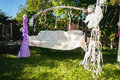 Beautiful decorated for wedding swing at backyard Royalty Free Stock Photo