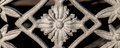 Beautiful decorative filigree cast aluminum fence panel with flo and ornamental or aluminium unpainted shining in the sunlight Royalty Free Stock Photos