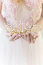 Beautiful delicate crown in the style of fine art at the hands of-girl bride Royalty Free Stock Photo