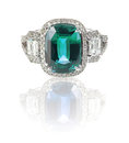 Beautiful Diamond ring with blue green gemstone center stone