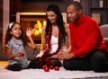 Beautiful diverse family at christmas home in time sorting decorations Royalty Free Stock Image