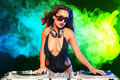 Beautiful dj girl on decks on the party Royalty Free Stock Photo