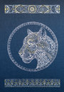 Beautiful dotwork snow leopard panther cat with ornament on blue background tattoo patterns and ornaments Royalty Free Stock Photography
