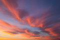 Beautiful dramatic sunrise blue sky with orange colored clouds Royalty Free Stock Photo