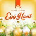 Beautiful Easter Background with flowers and colored eggs in the grass