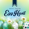 Beautiful Easter blue green Background with flowers and colorful eggs in the grass
