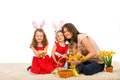 Beautiful easter family sitting togetheron carpet home Royalty Free Stock Photos