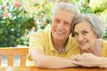 Beautiful elderly couple portrait of on wooden porch Stock Photography