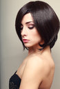 Beautiful elegant female model with black short hair Royalty Free Stock Images