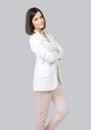 Beautiful elegant girl posing in studio isolated on gray Royalty Free Stock Photo