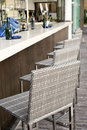 Beautiful elegant interior design, bar counter top with rattan chairs Royalty Free Stock Photo