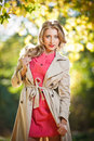 Beautiful elegant woman in autumn park Stock Photos