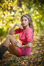 Beautiful elegant woman with long legs in autumn park Stock Photos