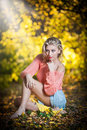 Beautiful elegant woman with long legs in autumn park Royalty Free Stock Photography