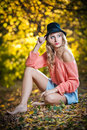 Beautiful elegant woman with long legs in autumn park . Stock Images