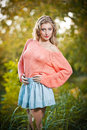 Beautiful elegant woman in pink sweater in autumn park . Royalty Free Stock Photography