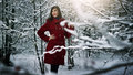 Beautiful elegant woman in red coat Stock Photos