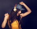 Beautiful emotional dancing and singing young woman listening th Royalty Free Stock Photo