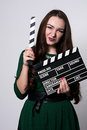 Portrait woman holding a movie clapper