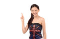 Beautiful english girl pointing up attractive with uk flag on her top isolated on white Royalty Free Stock Photo