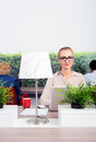 Beautiful environmentalist in office portrait of sitting at desk Stock Image