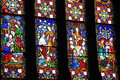 Beautiful example of the craftsmanship in stained glass windows on dark background Royalty Free Stock Photo
