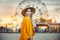 Beautiful exited smiling tourist woman having fun at amusement park at hot summer day trip on the beach Royalty Free Stock Photo