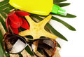 Beautiful exotic shell red flower and glasses on sand Stock Photos