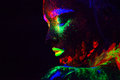 Beautiful extraterrestrial model woman with blue heair and green lips in neon light. It is portrait of beautiful model Royalty Free Stock Photo