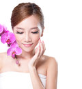 Beautiful face with pink orchids of young adult woman asian Royalty Free Stock Photography