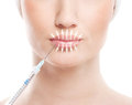 Beautiful face and the syringe plastic surgery of a young woman botox injection concept image is isolated on a white Royalty Free Stock Photos