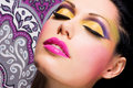 Beautiful face of a woman with fashion makeup closeup bright colour Stock Image