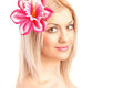 Beautiful face of woman with flower Royalty Free Stock Photos