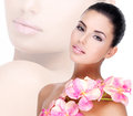 Beautiful face of woman with healthy skin and pink flowers young pretty on body isolated on white Stock Photography