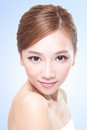 Beautiful face of young adult woman with clean fresh blue background asian Stock Photography