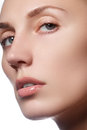 Beautiful face of young adult woman with clean fresh skin - isolated. Beautiful girl with beautiful makeup, youth and skin care