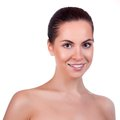 Beautiful face of young adult woman with clean fresh skin isolated on white Stock Photography