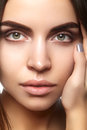 Beautiful face of young woman. Skincare, wellness, spa. Clean soft skin, healthy fresh look. Natural daily makeup