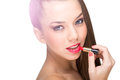 Beautiful fair skinned woman using a red lipstick Royalty Free Stock Image