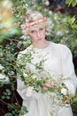 Beautiful fairy girl in roses garden Royalty Free Stock Photo
