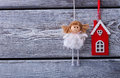 Beautiful fairy in a white dress and red house on a wooden fence Royalty Free Stock Photo