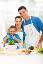 Beautiful family cooking young in kitchen at home Stock Photo
